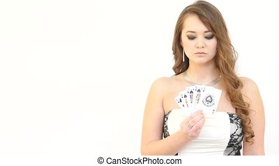 Pretty Girl with Fan of Cards Winks on White Background