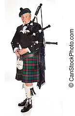 Scottish bagpipes - Scottish highlander wearing kilt and...