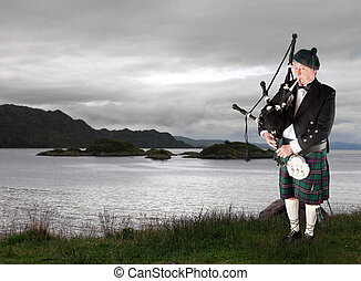 Scottish music - Scottish highlander wearing kilt and...