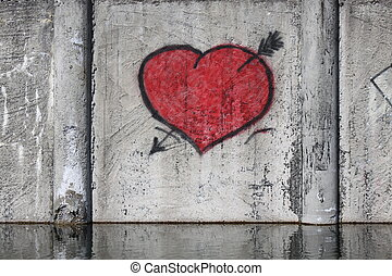 Red heart on a fence