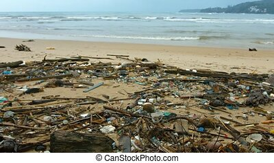 Tropical Beach Covered in Litter and Debris video - White...