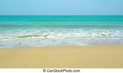 Gentle Waves Breaking on a Pristine Tropical Beach -...
