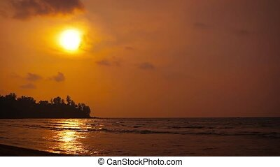 Golden Sun Rays over a Tropical Beach as Sunset Approaches -...