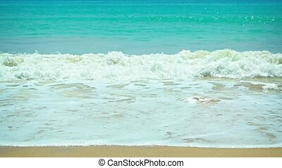 Gentle Waves Wash a Pristine Tropical Beach - Warm, blue...