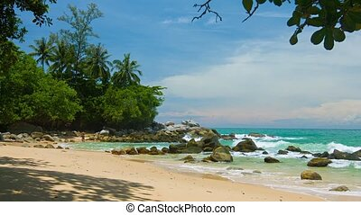 Tourists Enjoying an Exotic Tropical Beach with Boulders and...