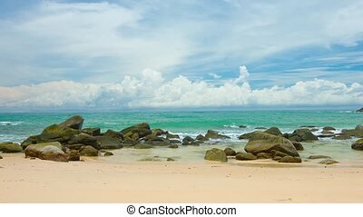 """Gentle Waves Break over a Rocky, Tropical Beach, with..."