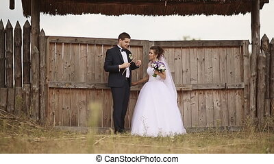 Groom playing the flute for the bride of straw. Kneeling...