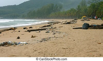 Tropical Beach with Heaps of Garbage - Heaps of litter and...