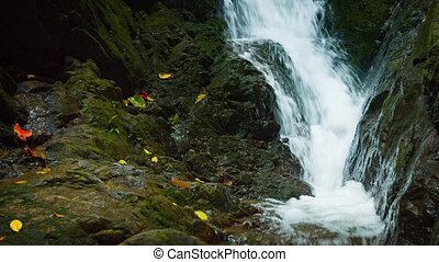 quot;White Water Rushes down a Rocky Natural Waterfall, with...