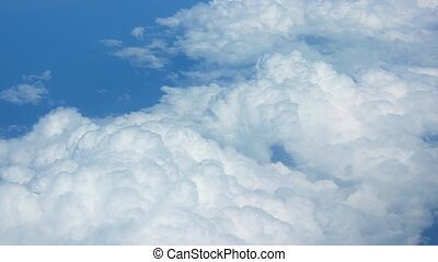 Airborne view of puffy clouds from above