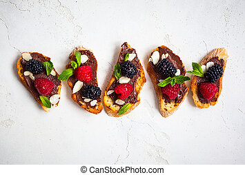Berry bruschetta - Sweet berry bruschetta with chocolate nut...