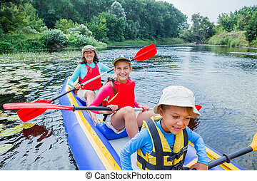 Family kayaking on the river - Active happy family. Girl...
