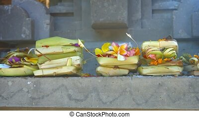 """Offerings to Hindu Gods at Tirta Empul Temple in Bali,..."
