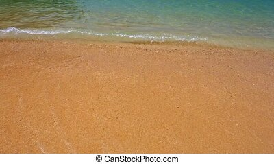 Closeup of Gentle Waves on a Tropical Beach - Closeup clip...