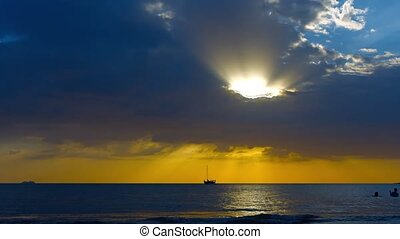 Sailing Yacht at Anchor and Tourists Swimming at Sunset -...