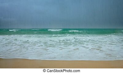 Waves of a Tropical Sea under Heavy Rains - Heavy, seasonal...