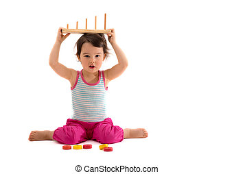 Child playing with educational cup toys. Isolated on white background