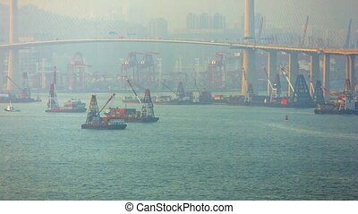 Barges and Commercial Shipping under an Urban Bridge -...