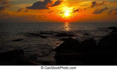 """Dramatic, Colorful Sunset over a Rocky, Tropical Beach"" -..."