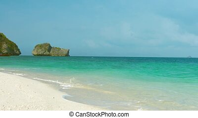 Gentle Waves on a Tropical Beach as a Boat Passes - Gentle...