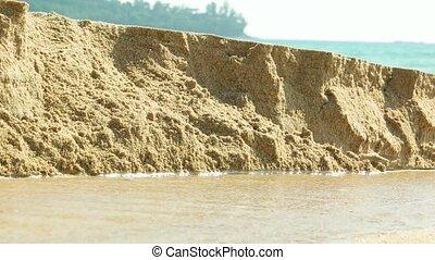"""Rain Runoff Eroding Beach Sand - """"Rain runoff erodes sand,..."""