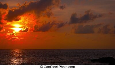 Sunset Colors over the Horizon of a Flat Tropical Sea - Sun...