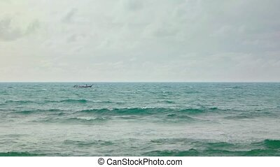 Fishermen in a Small Boat on a Tropical Sea - Fishermen at...