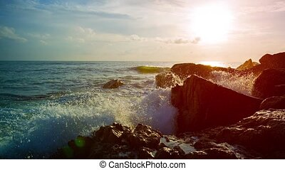 Gentle Waves of a Tropical Sea Splashing over Rocks - Gentle...