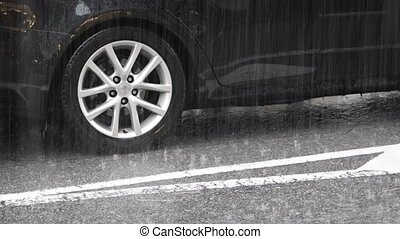 Heavy Rain on Urban Street and Cars. video - Heavy rain...