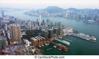 Overlooking View of Hong Kong's Cityscape as Dusk...