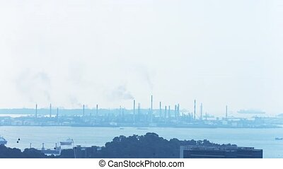 Extreme Zoom of an Industrial Cityscape with Smoke Stacks.