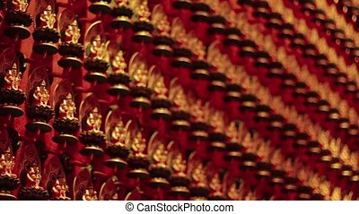 """Hundreds of Identical, Miniature Buddha Statues at the Temple"""