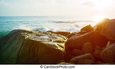 Gentle Waves Splash against Boulders in the Late Afternoon....