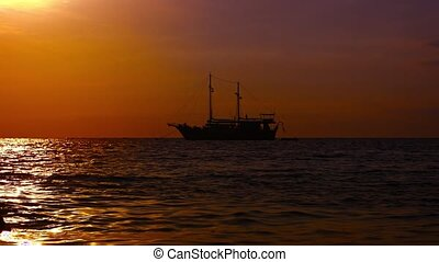 Sailing Yacht Silhouetted against the Tropical Horizon at...