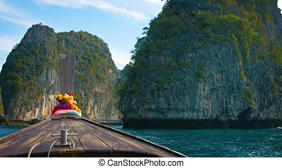 Cruising amongst Limestone Formations on a Longtail Boat in...