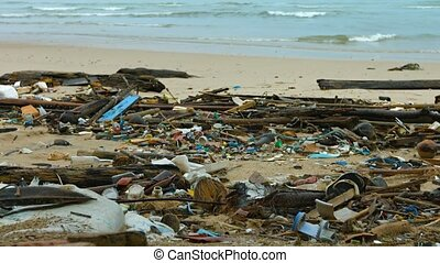 "Garbage Strewn on a Sandy Tropical Beach. - ""Physical..."