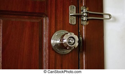 Man's Hand Locking a Wooden Door. Video - Man's hand reaches...