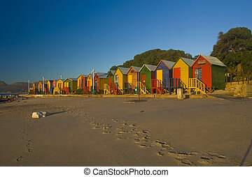 A row of brightly colored beach huts. Taken at St James, South Africa