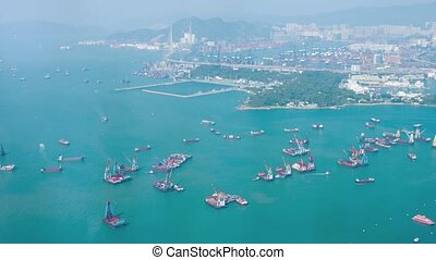 Barges and Commercial Cargo Ships in the Harbor off Hong...