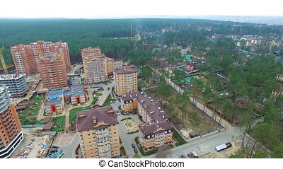 unfinished construction of multi-storey buildings aerial...