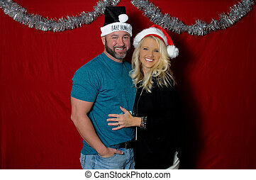 Portait of couple in Christmas photo booth - Cute couple in...