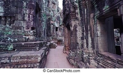 Strolling on an Ancient Pathway at Bayon Temple in Cambodia...
