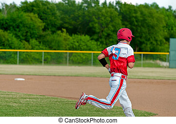 Teen baseball boy running to first base - Baseball player...