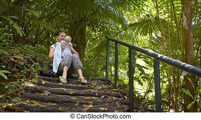 Hiker Pauses to Rest with her Baby on a Nature Trail - Happy...