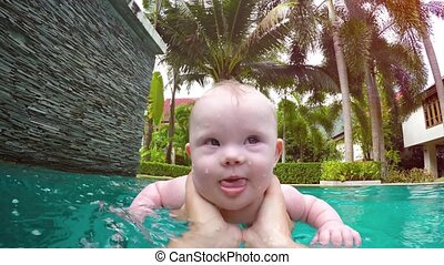 Happy Baby Learning to Swim with Mommy