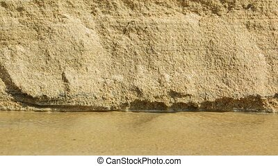 Erosion of Beach Sand by Rain Runoff - Loose sand trickles,...