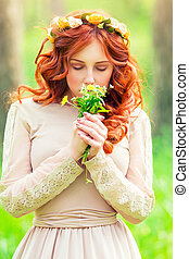 Romantic girl with wild flowers - Portrait of a beautiful...