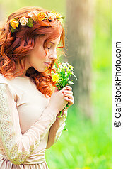 Gentle woman with wild flowers - Portrait of a beautiful...