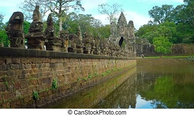 Ancient Sculptures along the Temple Moat at Angkor Wat -...