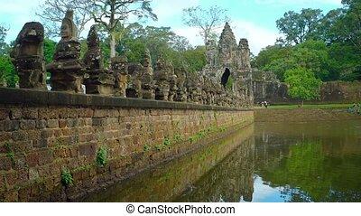 Ancient Sculptures along the Temple Moat at Angkor Wat -...